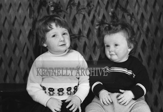 1953; A Studio Photo Of Two Children From A Family.