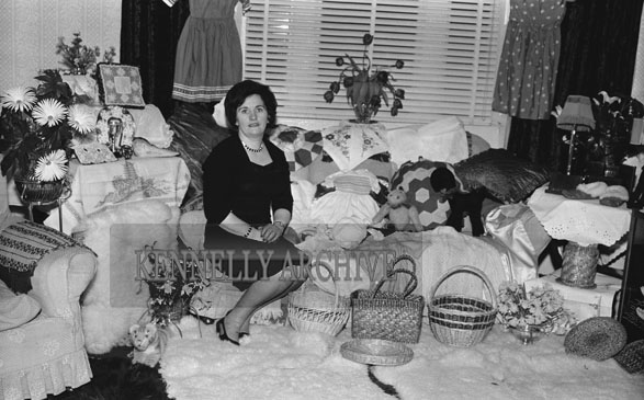 February 1962; Ms Sheila Horan poses for the camera at her home in Ballymullen in Tralee. She won the Brannra for making Sheepskin Rugs and Basket Weaving.