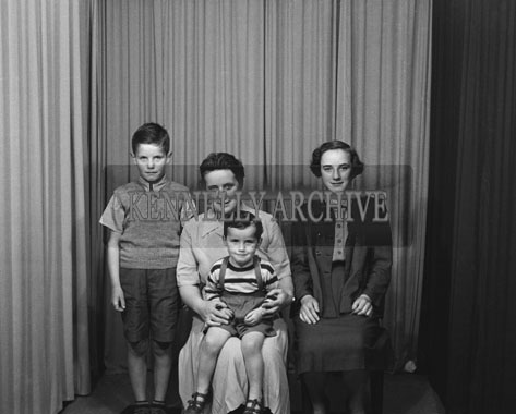 August 1954; A Studio Photo Of A Family.