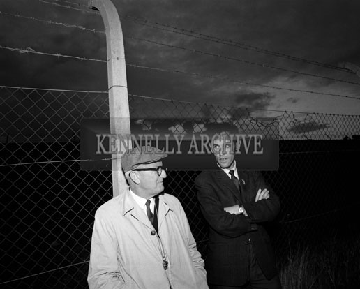 September 1964; Kerry trainer Dr Eamonn O'Sullivan and runner Tom Riordan watch the Senior Kerry Football Team at a training session.