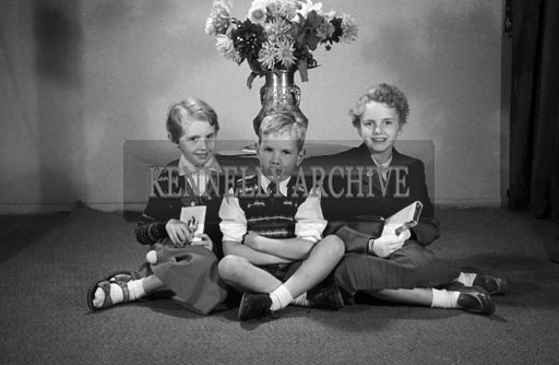 September 1957; A Confirmation studio photo of Miss Horan, Ballyheigue with her brother and sister.