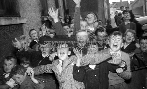 15th September 1957; A group of boys smile for the camera on Confirmation Day at Strand Street School.