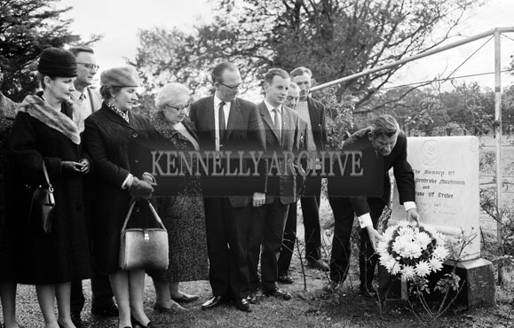 13th October 1964; Mr Florence O'Connor, Festival of Kerry President, lays a wreath at The Mulchinock Memorial Stone to mark the Centenary of the death of William Pembroke Mulchinock, who wrote the song 'The Rose of Tralee'. Members of the Festival of Kerry committee are also present.