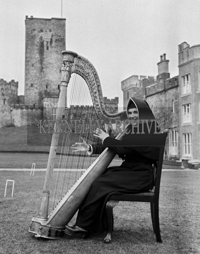20th February 1966; A nun plays the Padraig Pearse Harp, from his School, St. Enda's, which was presented to Drishane Convent, Millstreet.