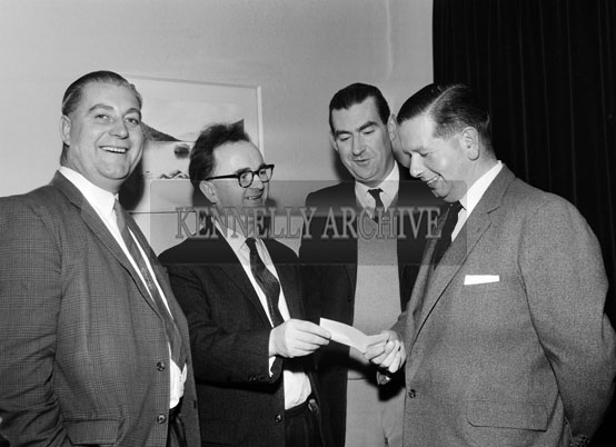 2nd December 1964; Mr. Brennan Byrne, Advertisng & Sales Promotions Manager, Beamish & Crawford Ltd., Cork, presents a cheque to Roger Harty a director of Ballybeggan Park Co. and Chairman of Kerry Coursing Club at a press conference in Tralee. Also present were Brendan Halnan, District Manager, Beamish & Crawford (left), and Joe Grace.