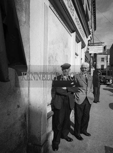 October 1962; A photo of two men taken on Dominic Street in Tralee.