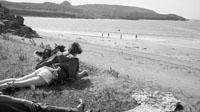 1953; A Couple Enjoying Themselves Near The Beach With Their Dog On Valentia Island.