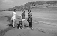 1953; Three Ladies Enjoying Themselves On The Beach With Their Dog On Valentia Island.