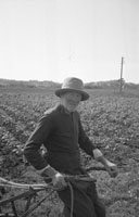 1953; A Farmer Working On His Land On Valentia Island.