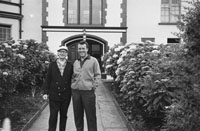 1953; Eamonn Andrews and a friend Standing Outside The Royal Hotel On Valentia Island.