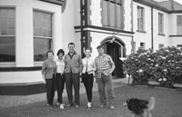 1953; Eamonn Andrews (centre) and friends Standing Outside The Royal Hotel On Valentia Island.
