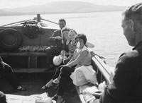 1953; Eamonn and Grainne Andrews (centre) Enjoying Themselves On A Boat Trip Off Valentia Island.