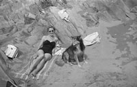 1953; A Lady Relaxing With Her Dog On The Beach On Valentia Island.