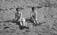 1953; A Photo Of Two Ladies Relaxing On The Beach At Valentia Island.