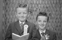 Studio Photo Of A Communion Boy And A Confirmation Boy.