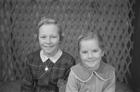 1953; A Studio Photo Of Two Girls.