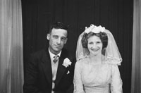 1953; A Studio Photo Of A Bride And Groom Posing For The Camera.