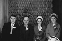 1953; A Studio Photo Of A Wedding Party Posing For The Camera.