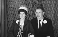 1953; A Studio Photo Of A Wedding Couple Posing For The Camera.