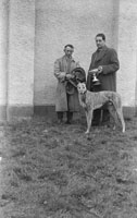 26th-28th December 1953; Two men with a winning dog in Ballybeggan Park during the Kingdom Cup coursing meeting.