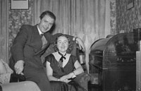 December 1953/January 1954; A Couple Posing At A Social At The Meadowlands Hotel.