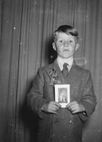 A Studio Photo Of A Communion Boy