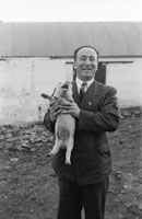 4th February 1956; A Man With A Piglet At The Home Of  Annie Mai Donegan, The Queen Of Plough, In Causeway.