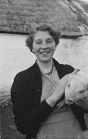 4th February 1956; Annie Mai Donegan, The Queen Of Plough, Posing For The Camera With A Pig In Causeway.