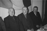 18th February 1956; Three Men Posing For The Camera At St. Mary's Social Celebrating The South Kerry County GAA Championship Team In Caherciveen.