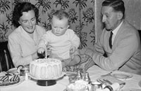 November 1956; A photo of of Mary and Norman McCann with their child on its First Bithday at home.