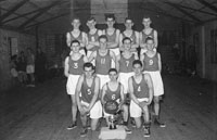December 1956; Members of an FCA basketball team pose for the camera at the Ballymullen Barracks in Tralee.