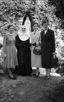 Group Of Women Pictured With A Nun