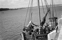 5th July 1956; The blessing the fishing boat 'Walblo' at the pier in Fenit.