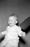 May 1957; A studio photo of a baby.