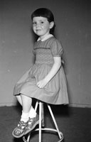 May 1957; A studio photo of a young girl.