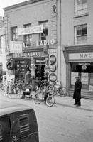 A Photo of Ned Caball's Bicycle Shop and Mack's Bar