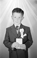 A Studio Photo of a Communion Boy