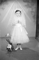 May 1957; A Communion photo of the Hannifin girl, taken in the studio.