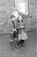December 1957; A photo taken with Santa at Castledrum National School.