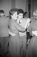 December 1957; A photo of young people enjoying themselves at a teenage dance.