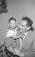 A Photo of a Young Boy and a Man