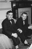 5th March 1957; Ted Hennessy (left) sitting with a gentleman at The TCLS (Tralee) Dress Dance in The Lake Hotel, Killarney.