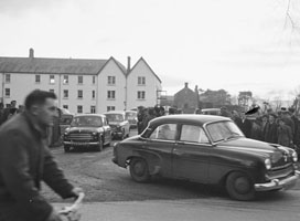 November 1958; The removal of 46 year old murdered farmer Mossie Moore from St Catherine's Hospital in Tralee. His body was found in a stream near his home in Raemore after a search that lasted for eight days.
