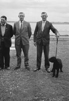 14th May 1961; A photo of three men and a dog in Croke Park on the day of the National Senior Football League Final between Kerry and Derry.