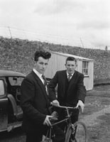 24th February 1962; A photo of twO men watching the FCA Exercises whichtook place at the Ballymullen Barracks.