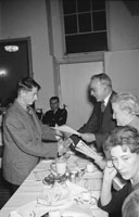 28th November 1962; A member of the Red Cross collecting a certificate at the Red Cross Social which took place at the Grand Hotel.