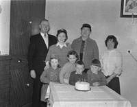 March 1962; The McElligott girl poses for the camera with her family at home in Oakpark at her fifth birthday party.