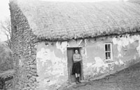 Photo Of A Woman Outside A House