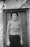 Photo Of A Woman Outside A House