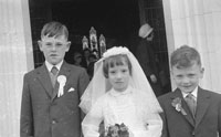 April 1962; A group of children pose for the camera on Confirmation Day in Kilflynn.